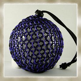 A chain mail dice bag holding (for some reason) a large styrofoam ball. Or maybe one of Zocchi's megalithic new d1000s.