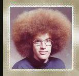 "Do not for even one moment think that this is Gamer Bling's high school yearbook photo. Good grief, no! It was discovered via Googling the word ""afro"". Gamer Bling mentions this so you can do so yourself and rest assured that Gamer Bling was never so styleless. Close, but not quite."